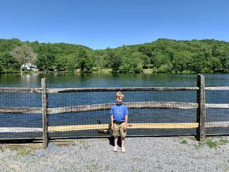 A little boy in front of St. John's Pond in Cold Spring Harbor