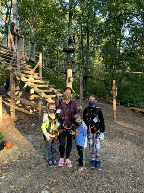 A mother and her 3 small kids at Adventure Park Long Island Ropes Course. Zipline & Ropes Courses on Long Island.