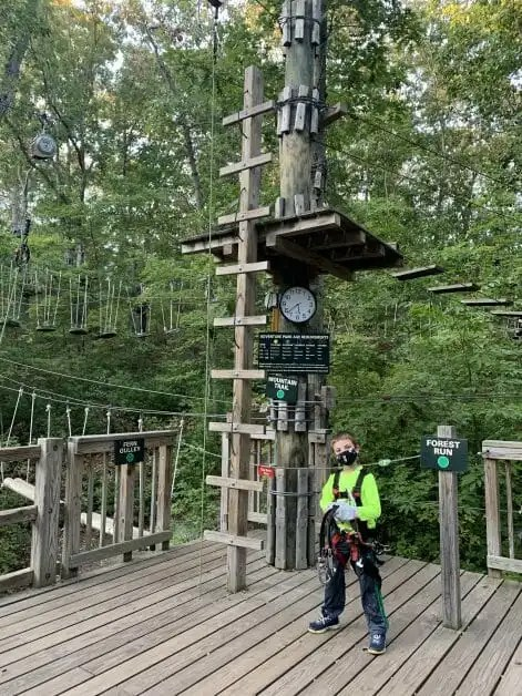 A 7 year old boy ready for a ropes course. Zipline & Ropes Courses on Long Island.
