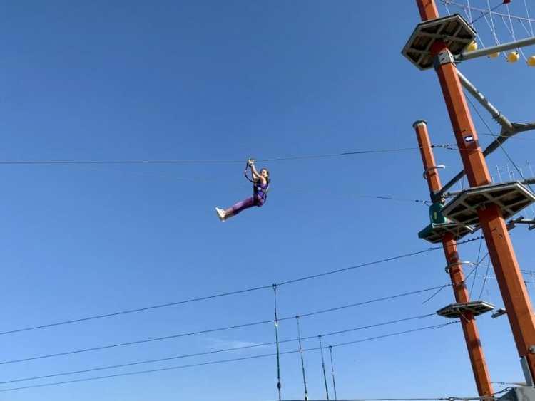 A tween on a zipline at Wild Play Jones Beach. Zipline & Ropes Courses on Long Island.