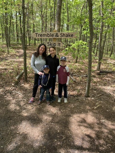 More Family Hikes on Long Island, A mom & 3 kids in front of 2 signs on a hike
