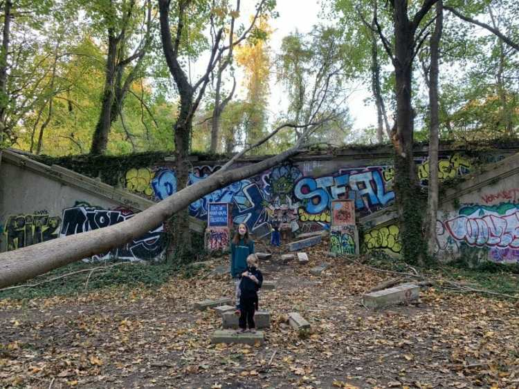 More Family Hikes on Long Island, 3 kids at Muttontown Preserve in front of King Zog's ruins
