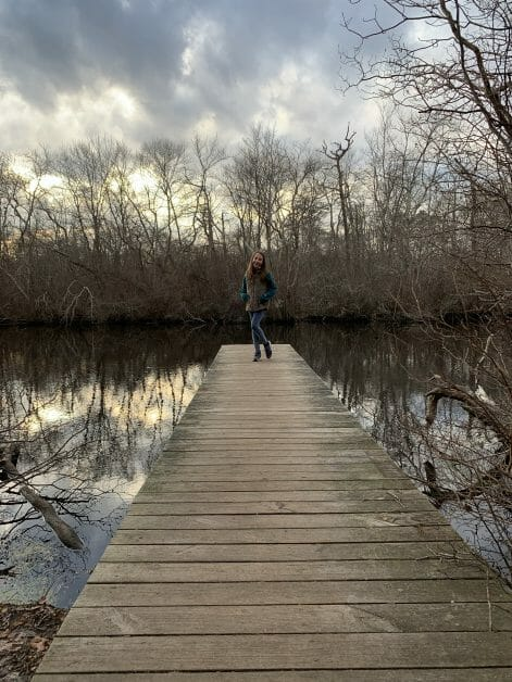 More Family Hikes on Long Island, a girl on a jetty at Connetquot State Park
