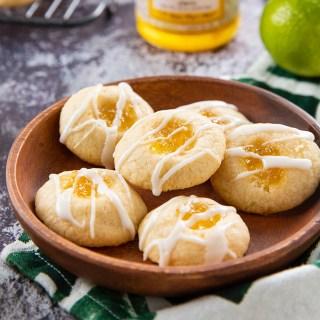 Pineapple Lime Shortbread Thumbprint Cookies #pineapple #shortbread #thumbprintcookie #lime #cookies #baking #ediblegift #dessertrecipe #dessert   The Missing Lokness