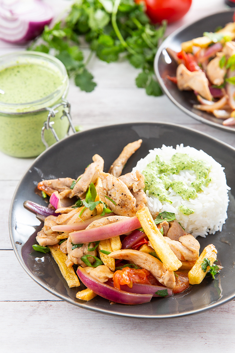 Pollo Saltado (Peruvian Chicken Stir-Fry) #peruvian #stirfry #chicken #frenchfries #copycatrecipe #elpolloinka #dinner #dinnerrecipe | The Missing Lokness
