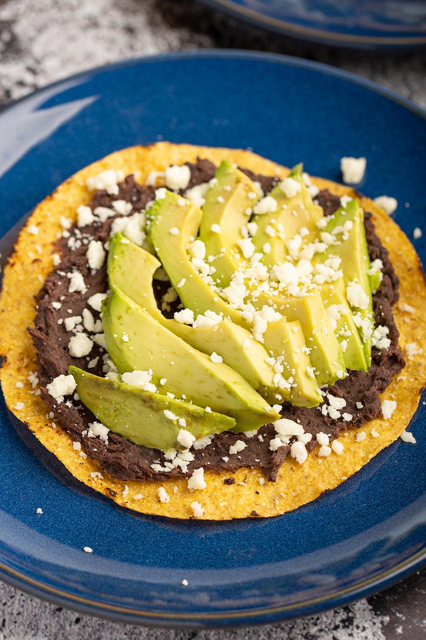 Avocado Tostadas #avocado #tostada #refriedbean #blackbean #cheese #cotija #easyrecipe #lunch #mexicanrecipe | The Missing Lokness