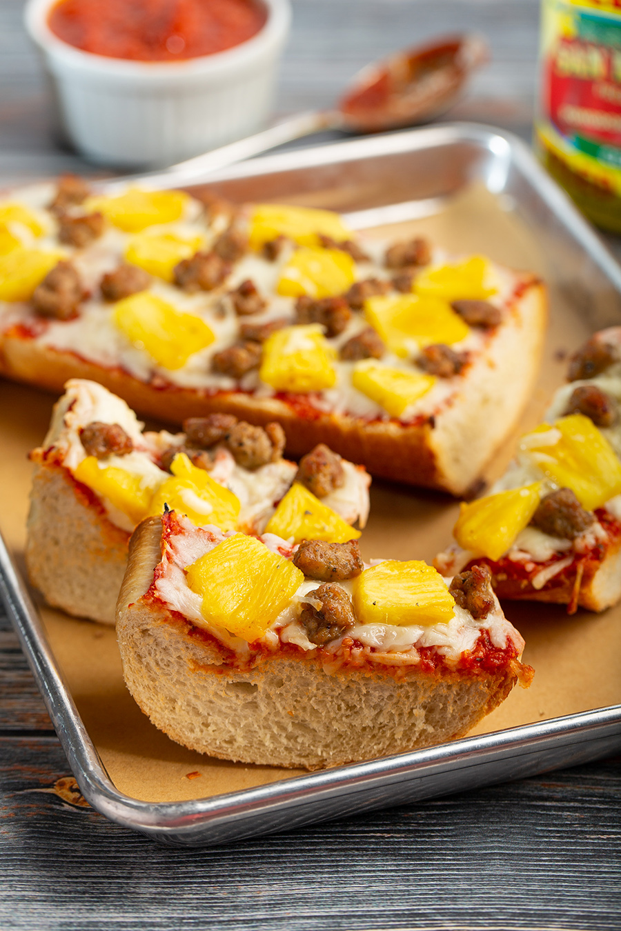 Sausage and Pineapple French Bread Pizza | Instead of making pizza dough, French bread can also be great for pizza. This version hits all the right notes, savory, sweet & tangy. #frenchbreadpizza #pizza #baked #pizzasauce #cheese #pineapple #sausage #dinner #dinnerrecipe #easyrecipe #weeknightrecipe | The Missing Lokness