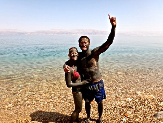 Covered in mud at the Dead Sea, Israel