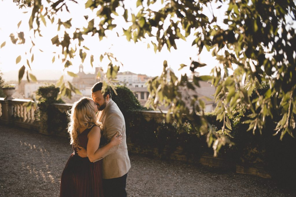Under the roman trees on our romantic photoshoot for couples