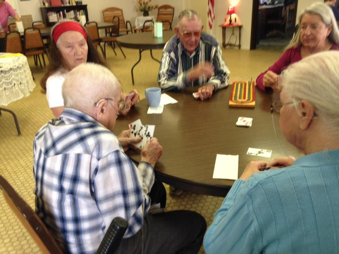 Harry Russell and friends play an afternoon game of cribbage at the Dixon Senior Center.