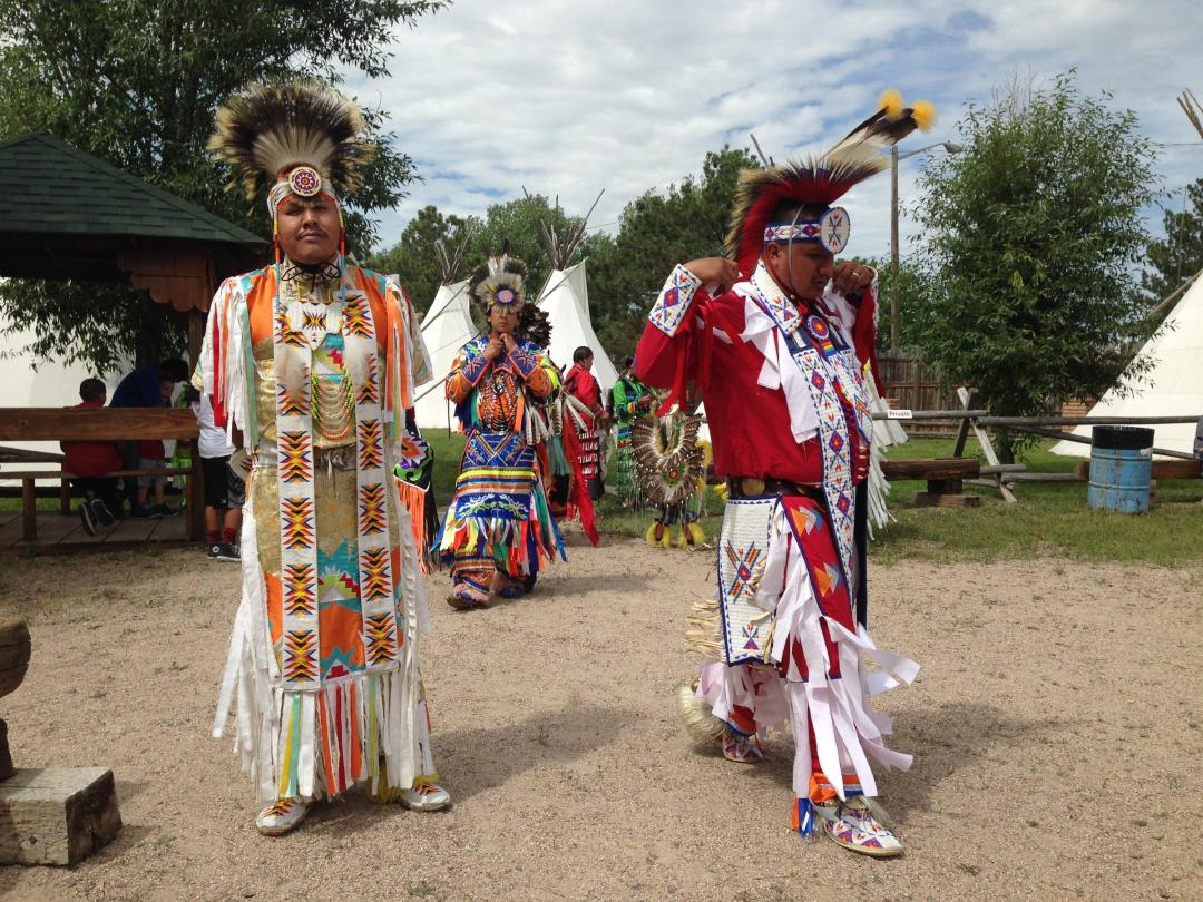Dancers prepare for a traditional dance.