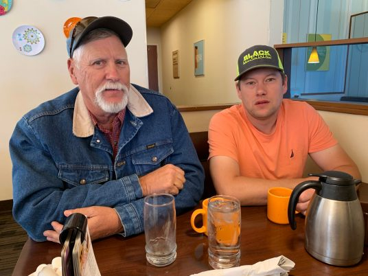 Gary (left) and his son Ty Cordingly sitting at a booth in Gillette's Village Inn.