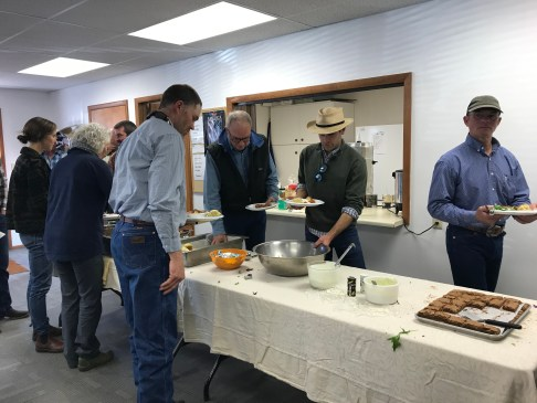 Ranchers line up for lunch at a meeting in Montana's Ruby Valley.