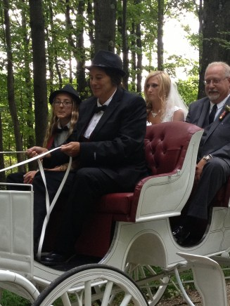 carriage ride through the woods to ceremony