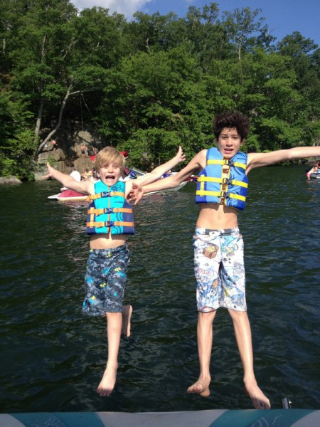 Charlie and a friend jumping off boat.