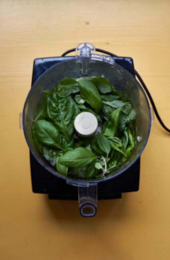 Basil in the Food processor for pesto
