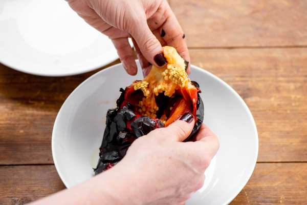 Removing seeds and stem from a roasted pepper