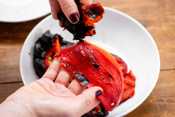 Peeling skin off a roasted pepper