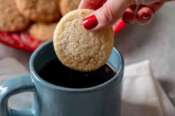 Dipping Pamela's cookie in a cup of coffee