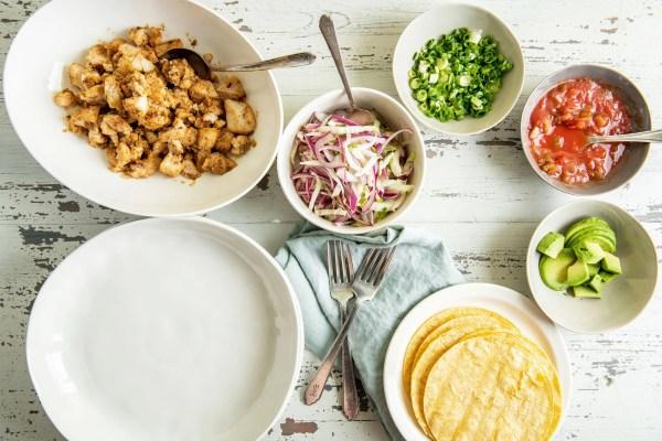 Alaska Rockfish and taco toppings in bowls