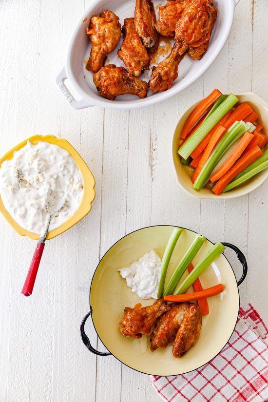 a serving Air Fryer Buffalo Chicken Wings with blue cheese dip and carrots and celery