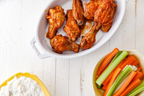Air Fryer Buffalo Chicken Wings with carrots and celery and blue cheese dip