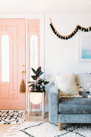 tour-a-bright-boho-chic-new-jersey-home-designed-on-a-budget-cara-irwin-of-goldalamode-home-tour-pink-door-black-tassel-garland-596e35ee44642b1236ba3dd2-w1000_h1000