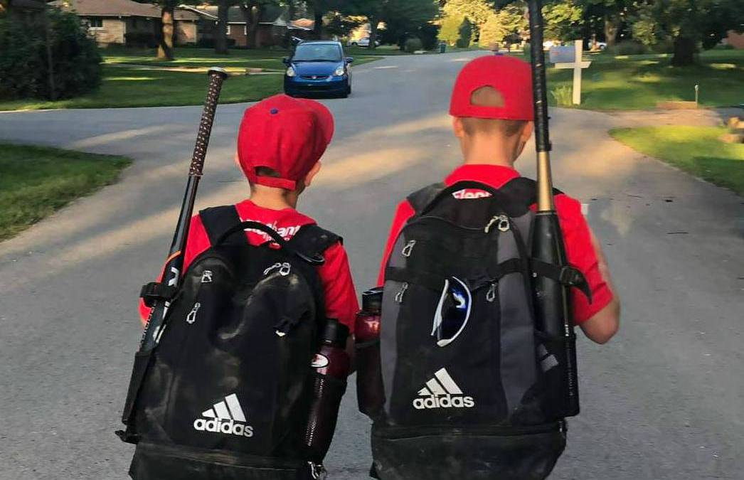 The Mom Huddle Sport of Busy- boys after baseball game walking home