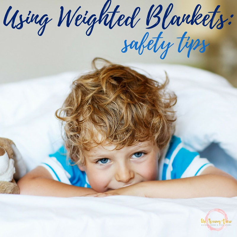 boy in bed with text overlay 'using weighted blankets safety tips'