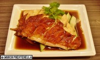 Wee Nam Kee's trademark roasted Hainanese chicken; you can order this steamed too.