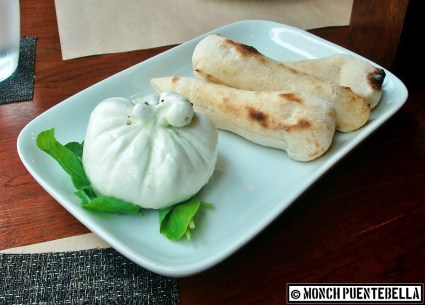 Burrata Cheese Plate (P295): The sturdy mozzarella packet conceals cream cheese within.