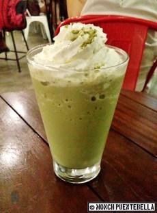 Green Tea Frappe (P155): Green tea latte blended with ice, topped with whipped cream and matcha powder.