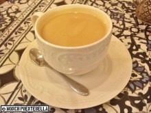 HOT MASALA CHAI: Indian black tea brewed with milk, sugar, and an assortment of spices, served warm in a cup and with a richer texture.