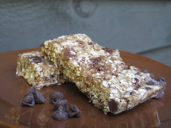 Chewy Crunchy Granola Bars on brown plate with chocolate chips