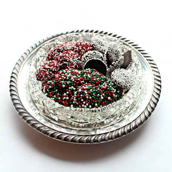 A variety of colors of Nonpareil Candies in a silver and crystal candy dish