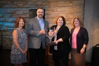 TMA President Pam Petrow, TMA Monitoring Center of the Year Vivint's Mike Tupy and Amy Becht, and SDM Editor Karyn Hodgson