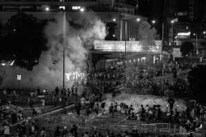 Tear gas deploying. Background: Central, the richest economic district in Hong Kong.