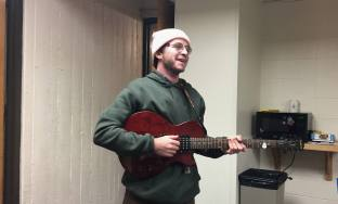Wolf Recht is a Botany major and loves playing his guitar.