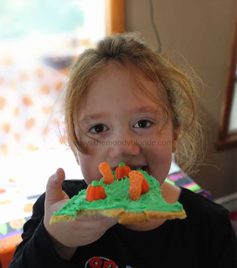 child eating zombie pumpkin patch cookie pizza