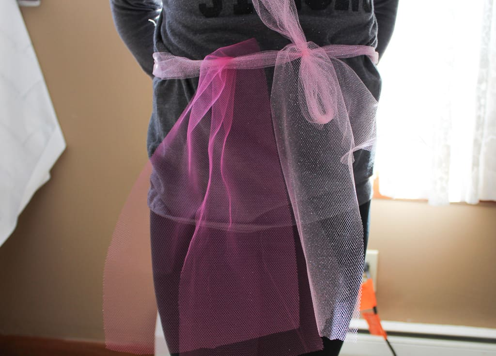 Ribbon wrapped around child to measure tutu length The Moody Blonde