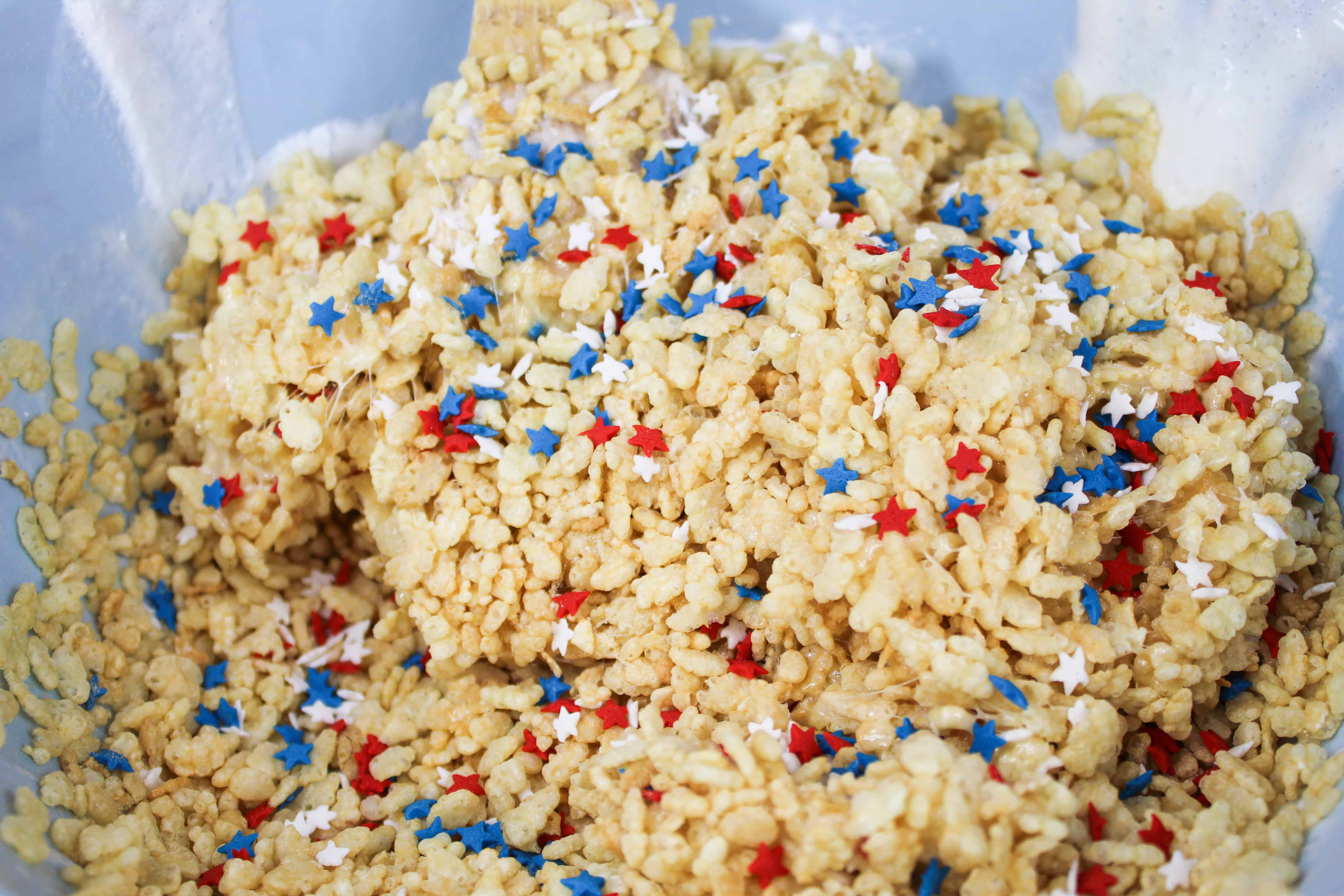 Drop in red and white sanding sugar and red and white star sprinkles to make yummy patriotic rice krispie treats