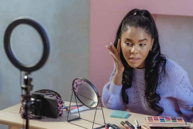 A focused digital content creators applying makeup and recording video make up artist, makeup artist,