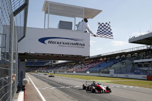 Verstappen takes the flag for his first F3 win. © FIA.
