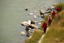 Monks walk under the Punakha suspension bridge by the river. Photo: Kaushik Naik