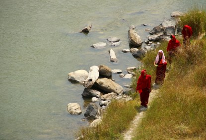 Monks walk under the Punakha suspension bridge by the river. Photo: Kaushik Naik