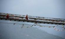 A monk on his way across the Punakha Suspension bridge. Photo: Kaushik Naik