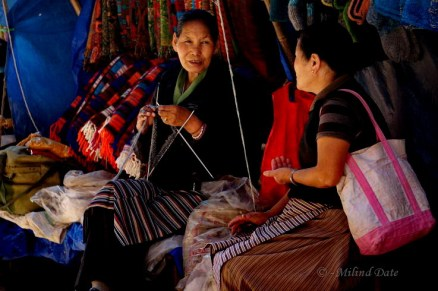 Woollen wear and conversation abound in the little shops in McLeodganj market. Photo: Milind Date.