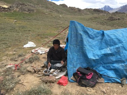 Kisang making tea for us before the last climb down to our camp; Photo: Sanjay Mukherjee