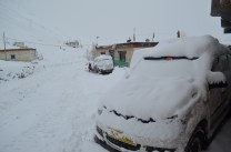 The morning site of our car, as the snowfall continues.