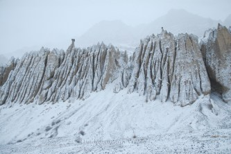 Snow settled on rock formations formed millions of years ago near Lidang.
